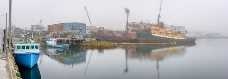 Derelict fishing vessels at marina in Nova Scotia