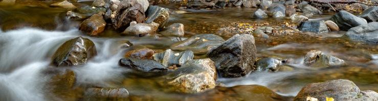 Large format panoramic of river rocks