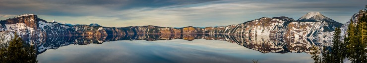 perfect reflection of crater rim in crater lake